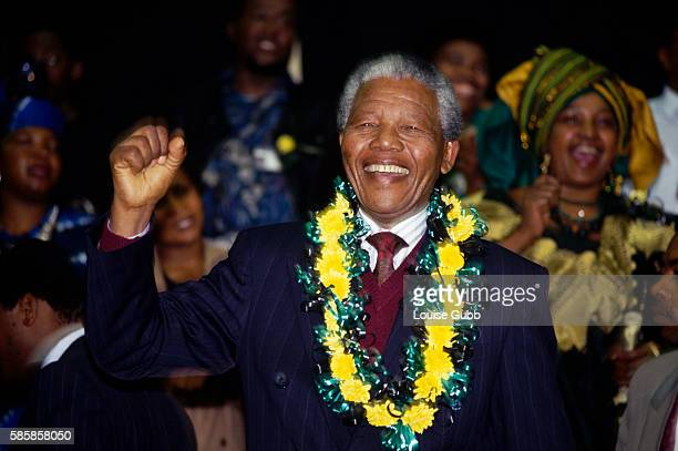 Winnie Mandela cheers her husband Nelson Mandela during his first ANC Conference in thirty years Former President of South Africa and longtime...