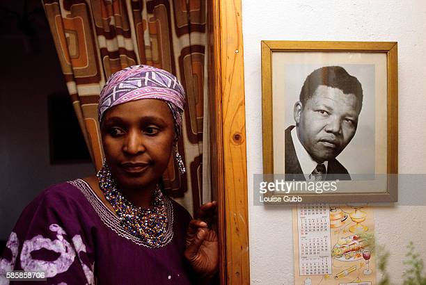 Winnie Mandela defies her ban orders not to return to her home and the picture of her husband Nelson Mandela a former President of South Africa and...