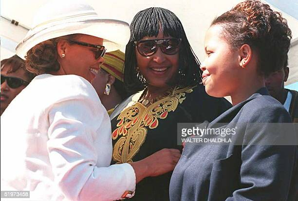 Winnie Mandela the estranged wife of the South African president Nelson Mandela talks with Limpho Hani the widow of Communist Party chief Chris Hani...
