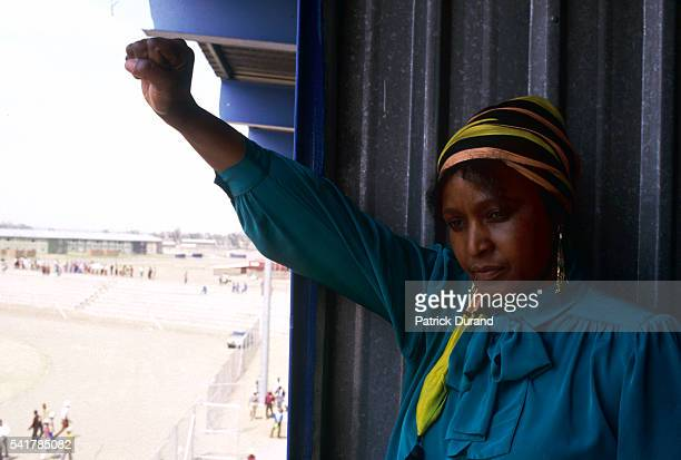 Winnie Mandela the wife of Nelson Mandela raises her fist in defiance during a miner's strike