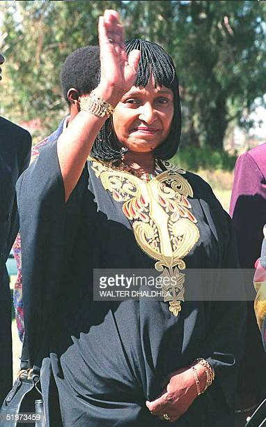 Winnie Mandela waves 15 April during the unveiling of the tombstone for slain South African Communist Party leader Chris Hani at Elsburg Park...