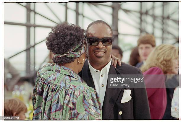 Winnie Mandela wife of antiapartheid activist Nelson Mandela hugs singer Stevie Wonder in Boston in 1990 Nelson Mandela who was recently released...