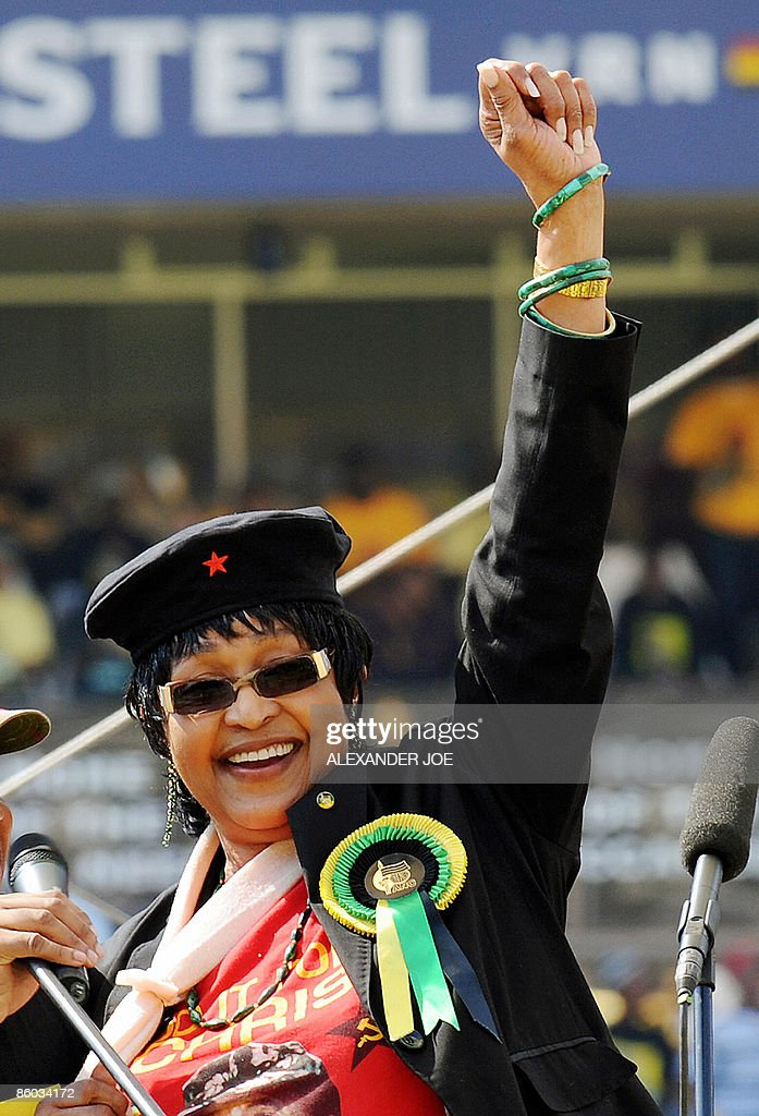 Winnie Mandela, wife of former South African President Nelson Mandela waves to the crowd in Johannesburg at Ellis Park stadium on April 19, 2009 at the final African National Congress election rally. Nelson Mandela made a surprise appearance drawing wild cheers from a throng of 100,000 people. After 15 years of democracy, the ANC is still the party of choice for the country's mainly black and poor majority who feel populist presidential candidate Zuma will address the challenges facing them.