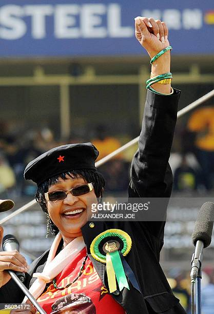 Winnie Mandela wife of former South African President Nelson Mandela waves to the crowd in Johannesburg at Ellis Park stadium on April 19 2009 at the...