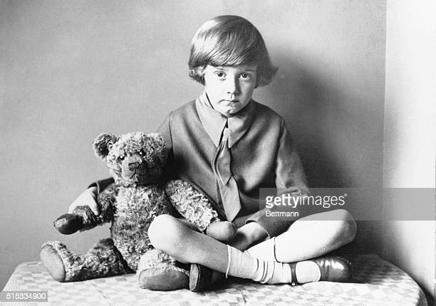 Winnie the Pooh author AA Milne's son Christopher Robin sitting at home with his teddy bear