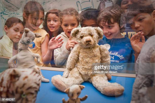 Winnie the Pooh NYC school children from PS 212 view the original Winnie the Pooh stuffed animals at a Return To The Hundred Acre Wood reading and...