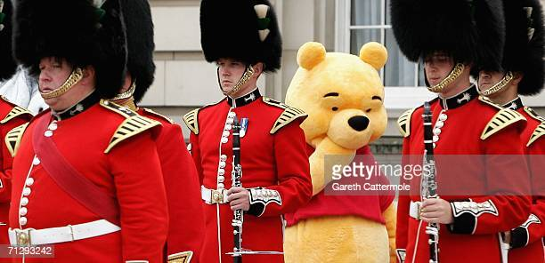 Winnie the pooh wanders around the Forecourt of Buckingham Palace for the Queen's 80th Birthday Children's Garden Party on June 25 2006 in London