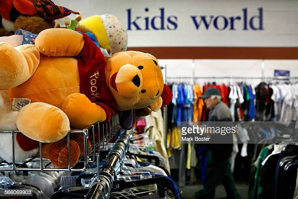 Winnie the Pooh watches over the children's clothing area at the Goodwill Store in Los Angeles Thrift stores are in a difficult position because of a...