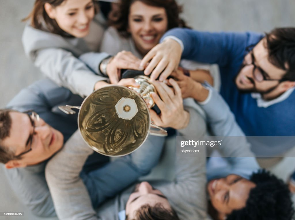 Winning a trophy for business achievement! : Stock Photo