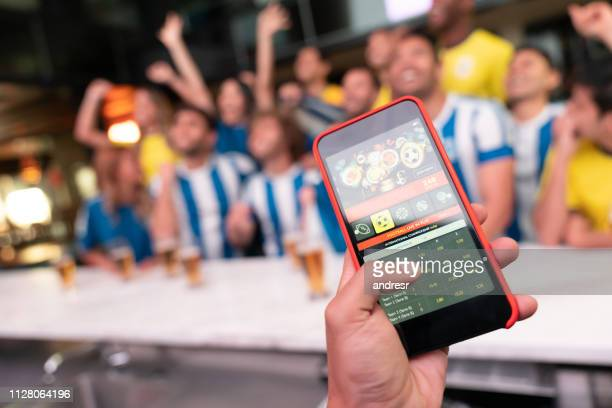 winning an online bet on a football game - match sport imagens e fotografias de stock