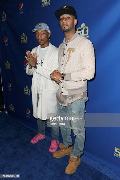 GRAMMY winning artist Pharrell and Swizz Beatz arrive at Pepsi Super Friday Night at Pier 70 on February 5 2016 in San Francisco California