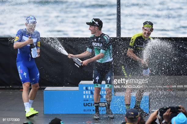 Winning Australian rider Jay McCarthy of BoraHansgrohe secondplaced Italian Elia Viviani of QuickStep Floors and thirdplaced South Africa's Daryl...