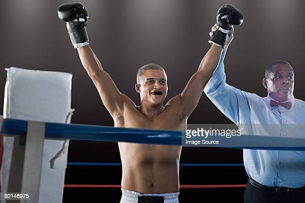 Winning boxer and referee