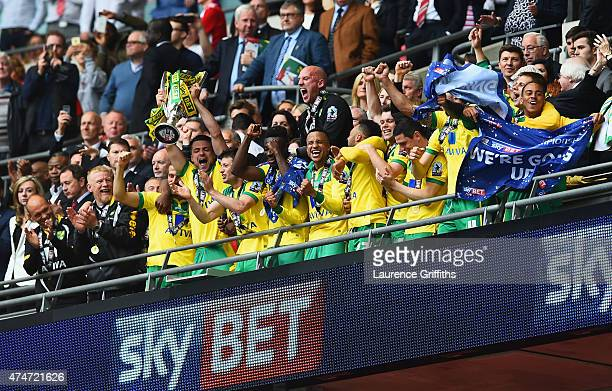 Winning captain Russell Martin of Norwich City lifts the trophy in celebration alongside team mates after the Sky Bet Championship Playoff Final...