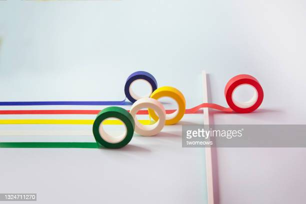 winning concepts coloured tapes rolling out still life. - competition group stock pictures, royalty-free photos & images