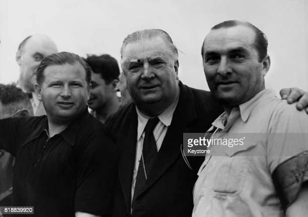 Winning driver Hermann Lang of Germany with Alfred Neubauer manager of the MercedesBenz Grand Prix team and Lang's codriver Fritz Riess at the 1952...