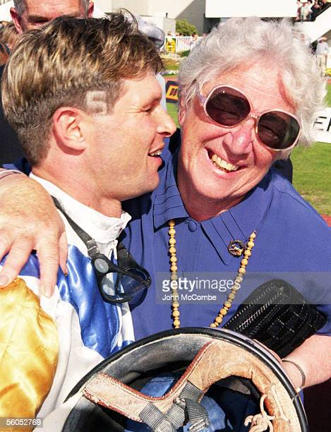 Winning driver of the 1999 New Zealand Trotting Cup Todd Mitchell is hugged by fan Mitchell cut his horse's number in his hair