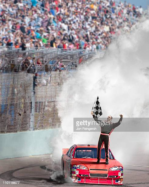 winning driver standing on hood of race car. - nascar stock pictures, royalty-free photos & images