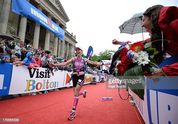 Winning female Lucy Gossage celebrates after completing Ironman UK on August 4 2013 in Bolton England
