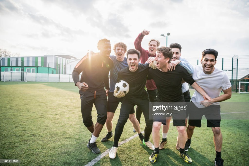 Winning football team cheering : Stock Photo