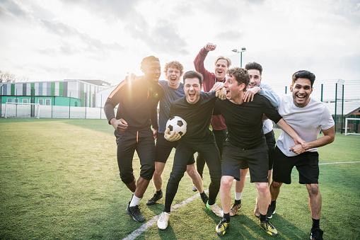 Winning football team cheering 954142634