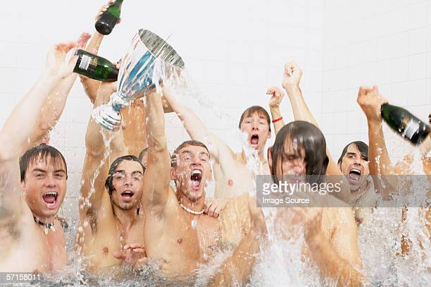 Winning football team in the bath