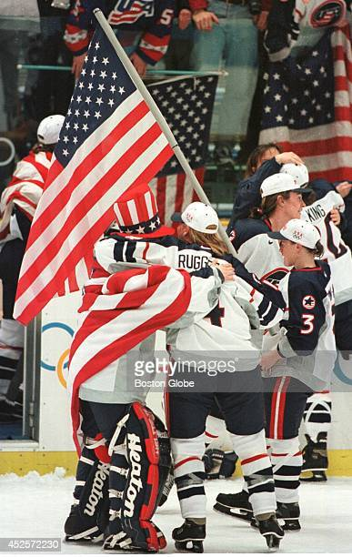 S winning goalie Sarah Tueting left is hugged by teammates Angela Ruggiero and Lisa BrownMiller The US beat Canada 31 to take the Olympic gold