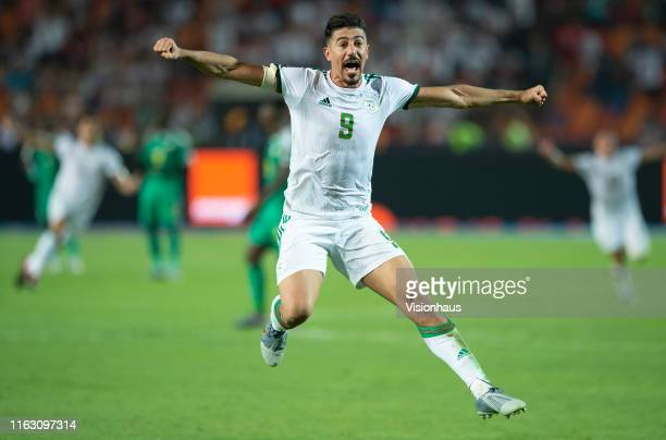 Winning goalscorer Baghdad Bounedjah of Algeria celebrates winning the 2019 Africa Cup of Nations Final between Senegal and Algeria at at the Cairo...