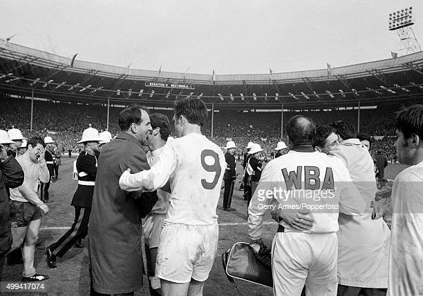 Winning goalscorer Jeff Astle with West Bromwich Albion manager Ron Ashman as the team celebrate victory on the pitch after the FA Cup Final between...