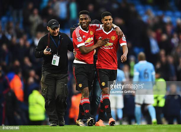 Winning goalscorer Marcus Rashford of Manchester United and team mate Timothy FosuMensah celebrate victory after the Barclays Premier League match...