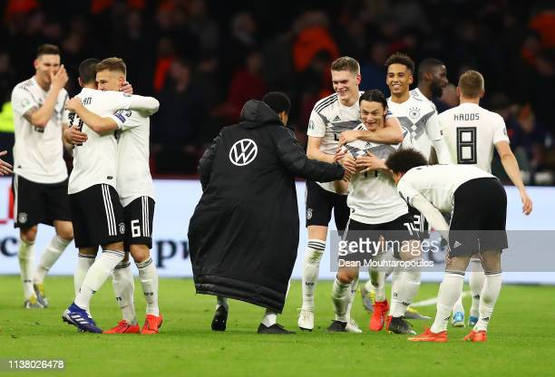 Winning goalscorer Nico Schulz of Germany celebrates victory with team mates after the 2020 UEFA European Championships Group C qualifying match...