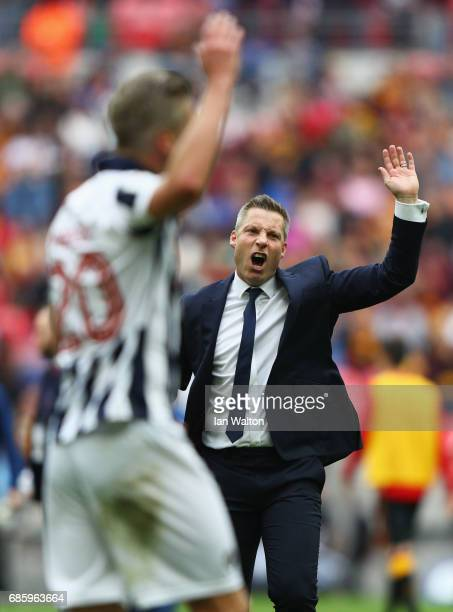 Winning goalscorer Steve Morison of Millwall and Neil Harris manager of Millwall instruct invading Millwall fans to leave the pitch after victory in...