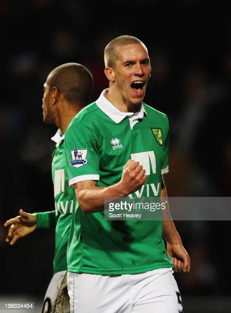 Winning goalscorer Steve Morison of Norwich City celebrates at the final whistle following the Barclays Premier League match between Queens Park...