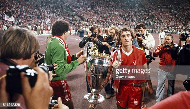 Winning goalscorer Trevor Francis and goalkeeper Peter Shilton parade the trophy after the 1979 European Cup Final between Nottingham Forest and...