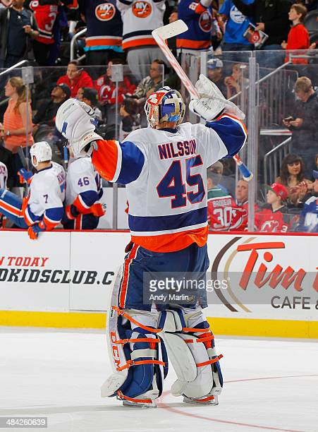 Winning goaltender Anders Nilsson of the New York Islanders reacts after defeating the New Jersey Devils in a shootout during the game at the...
