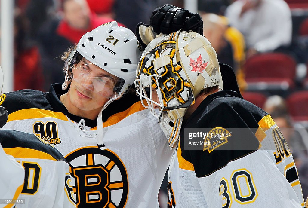 Winning goaltender Chad Johnson #30 of the Boston Bruins is congratulated by Loui Eriksson #21 after defeating the New Jersey Devils at the Prudential Center on March 18, 2014 in Newark, New Jersey. The Bruins defeated the Devils 4-2.