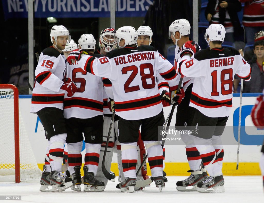 Winning goaltender Martin Brodeur #30 is congratulated by his teammates after the Devils defeated the Islanders at the Nassau Coliseum on January 19, 2013 in Uniondale, New York. The Devils defeated the Islanders 2-1.