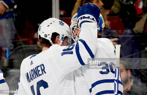 Winning goaltender Michael Hutchinson and Mitchell Marner of the Toronto Maple Leafs react after defeating the New Jersey Devils in overtime at the...