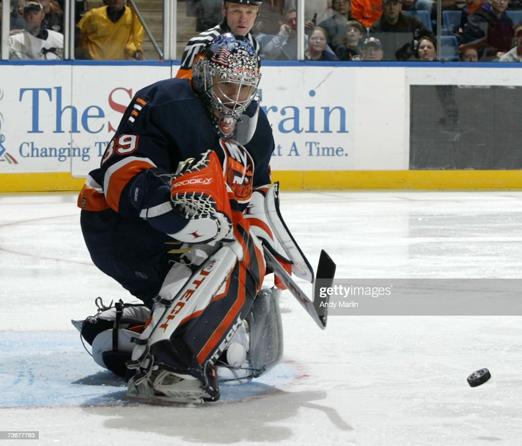 Winning goaltender Rick DiPietro #39 of the New York Islanders watches the puck after making a save against the Pittsburgh Penguins during their game at the Nassau Coliseum on March 22, 2007 in Uniondale, New York.