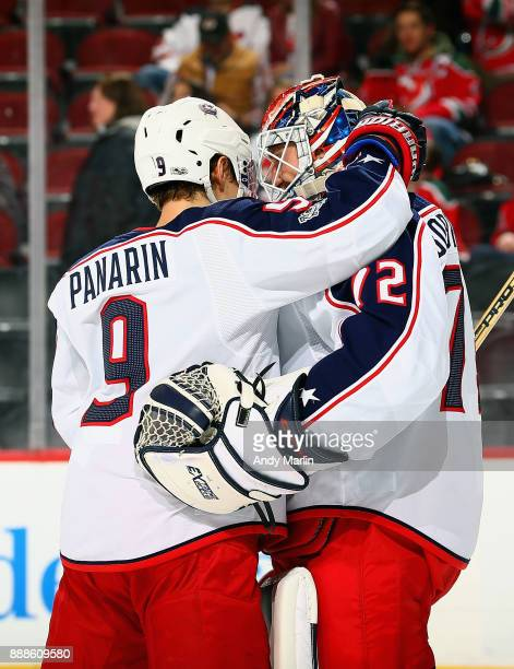Winning goaltender Sergei Bobrovsky of the Columbus Blue Jackets is congratulated by Artemi Panarin after defeating the New Jersey Devils 53 at...