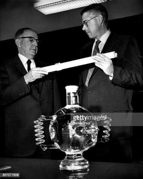 Winning Guesser Receives 22inch slide rule Charles O Vogt left presents prize to John A Krimmel Credit Denver Post