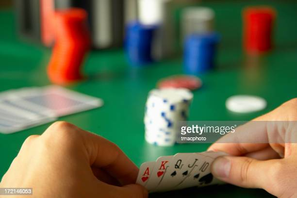 winning hand - hand of cards stock photos and pictures