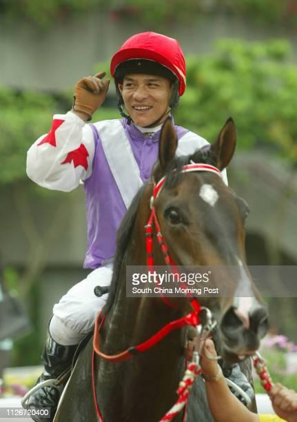Winning horse Joyful Spirit and jockey Weichong Marwing are led back after winning the Race 9 at Sha Tin Racecourse 18 May 2003