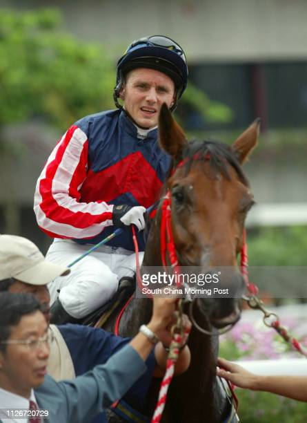 Winning horse Wealthy Treasure and jockey Shane Dye in a photo session after winnning the Race 2 at Sha Tin Racecourse 18 May 2003