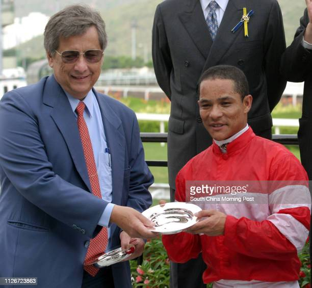 Winning jockey Weichong Marwing and horse trainer Ivan Allan receive a silver dish for the The Queen's Silver Jubilee Cup race after the jockey...