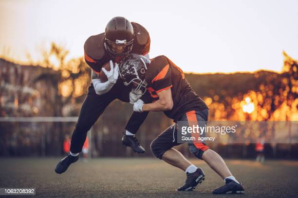 winning match - tackling stock pictures, royalty-free photos & images