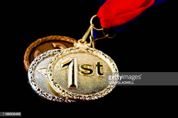 winning medals - third place stock pictures, royalty-free photos & images