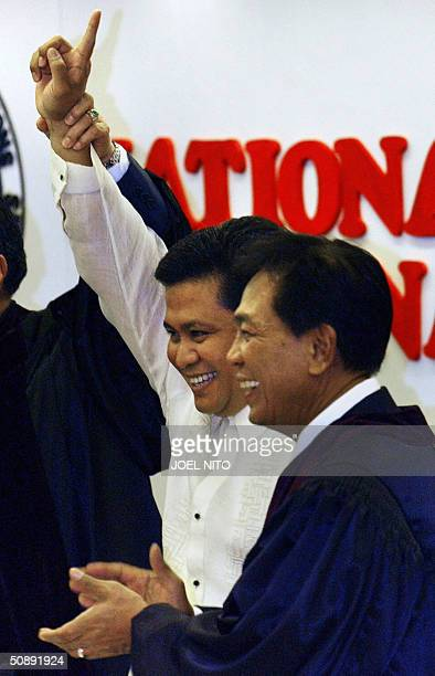 Winning Phillipines senatorial candidate Jinggoy Estrada son of jailed former president Joseph Estrada is applauded by Commission on Elections...