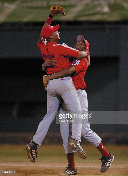 Winning pitcher Norge Luis Vera hugs Yulieski Gourriel of Cuba after they beat the USA during Men's Baseball at Quisqueya Stadium on August 12 2003...