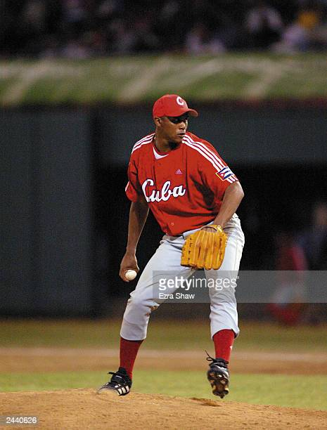 Winning pitcher Norge Luis Vera of Cuba looks to throw against the USA during Men's Baseball at Quisqueya Stadium on August 12 2003 at the XIV Pan...